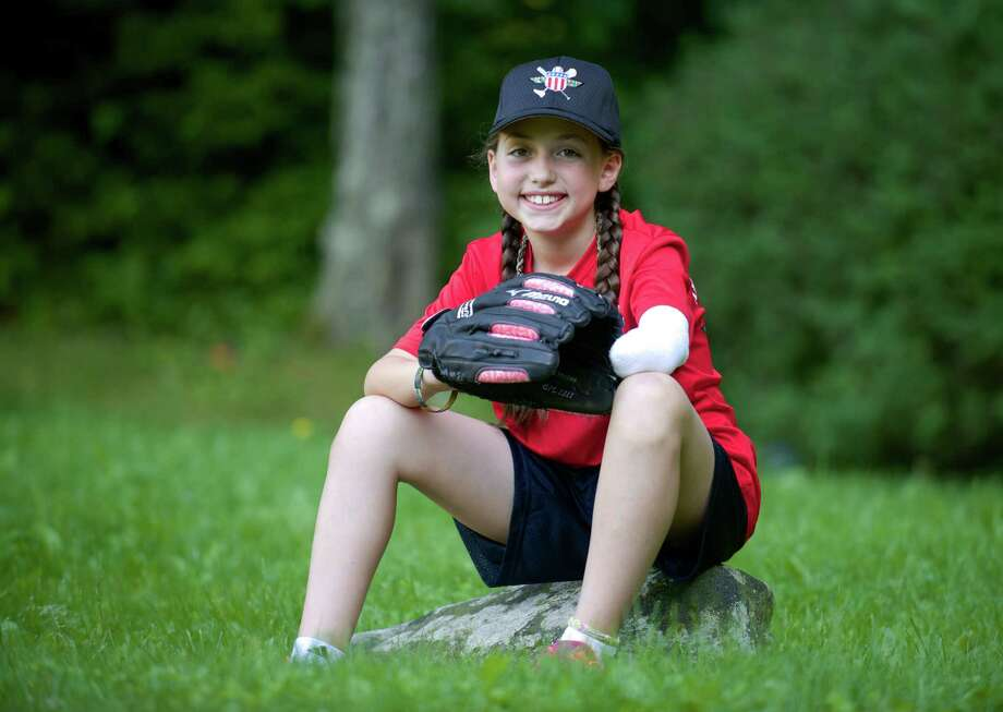 Jennifer Castro, 9, of New Fairfield, Conn, a local softball player, attended the Wounded Warrior Amputee Softball Team Kids Camp last week in Louisville, Ky.  Monday, June 16, 2014. Photo: H John Voorhees III / The News-Times Freelance