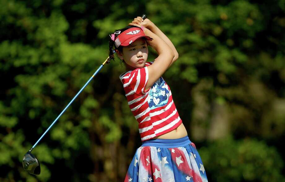 PINEHURST, NC - JUNE 19:  Eleven-year old Amateur Lucy Li of the United States takes a practice swing on the third hole during the first round of the 69th U.S. Women's Open at Pinehurst Resort & Country Club, Course No. 2  on June 19, 2014 in Pinehurst, North Carolina.  (Photo by Streeter Lecka/Getty Images) ORG XMIT: 461933907 Photo: Streeter Lecka / 2014 Getty Images
