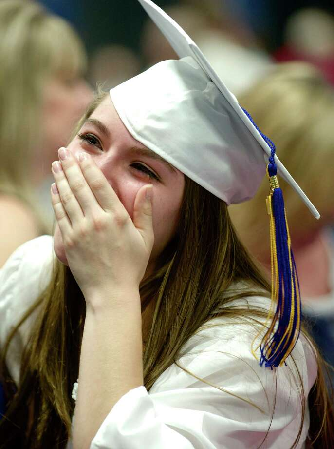 "Gabriella Cecere, 17, had tears in her eyes after the Henry Abbott Technical High School 2014 Graduation Ceremony, on Thursday, June 19, 2014. She said they were tears of joy and she was ""happy to be graduating with my best friend"" Katrina Fyler, of New Milford. The ceremony was held at the Western Connecticut State University O'Neill Center. Photo: H John Voorhees III / The News-Times Freelance"