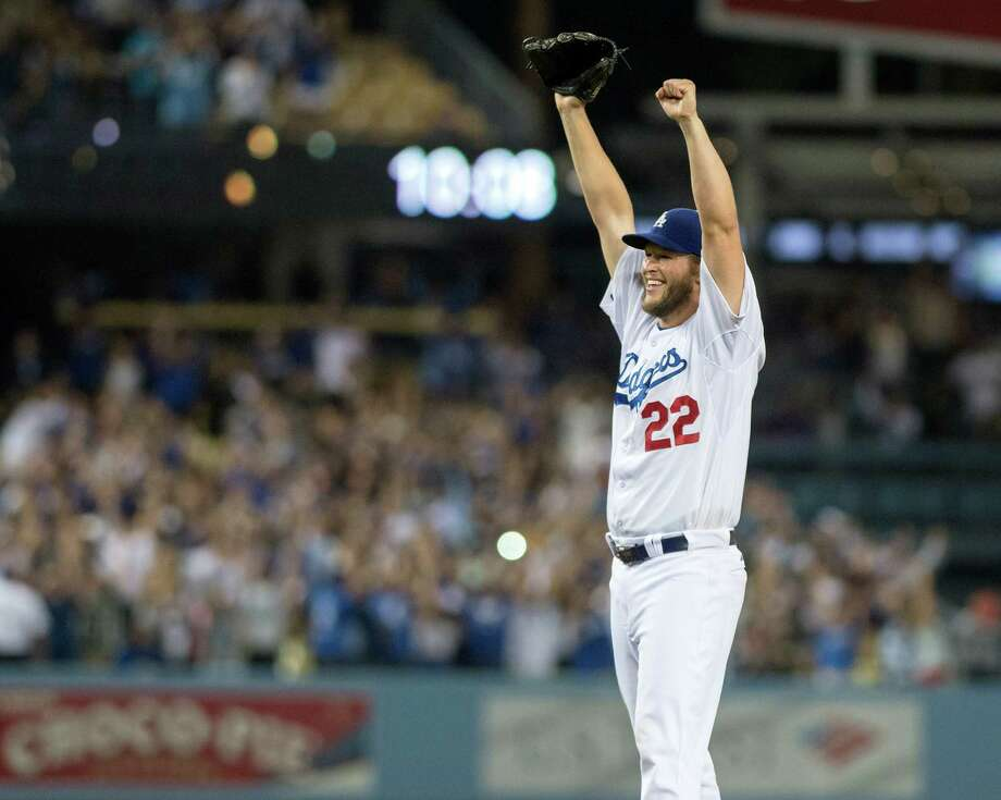 The Dodgers' Clayton Kershaw raises his arms after he recorded a no-hitter during a game against the Rockies at Dodger Stadium on Wednesday June 18, 2014. (AP Photo/The Orange County Register, Kyusung Gong) ORG XMIT: CAANR108 Photo: KYUSUNG GONG, / The Orange County Register