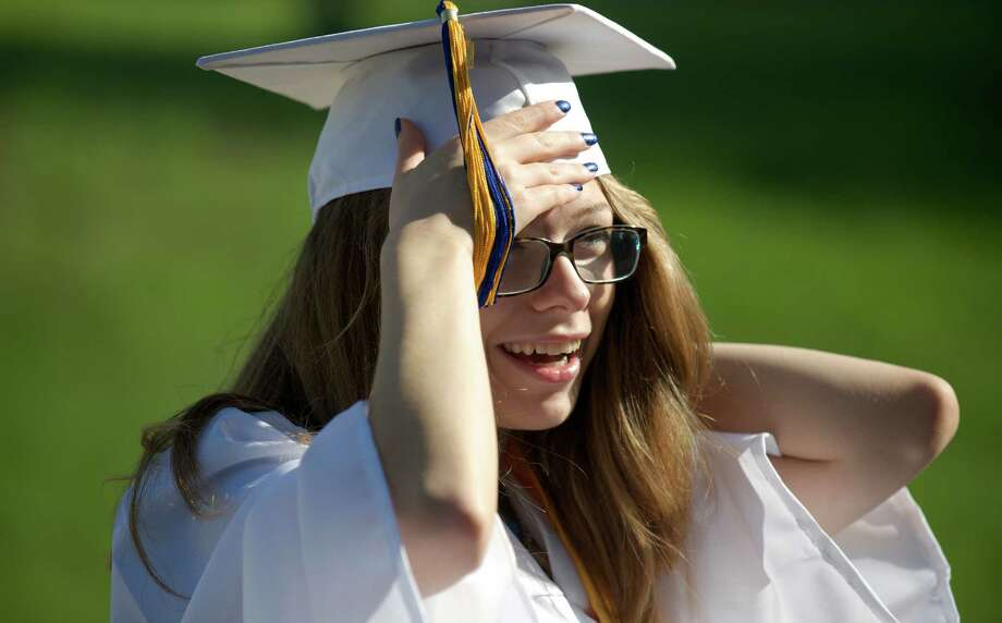 Carley Thompson, 18, of New Milford, adjusts her mortar board on her way into the Henry Abbott Technical High School 2014 Graduation Ceremony, on Thursday, June 19, 2014, held at the Western Connecticut State University O'Neill Center. Photo: H John Voorhees III / The News-Times Freelance