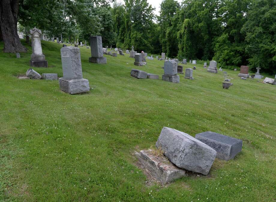 Headstones rest on the ground near their sites at the St. John's Cemetery Thursday afternoon June 19, 2014 in Troy, N.Y.    (Skip Dickstein / Times Union) Photo: SKIP DICKSTEIN / 00027441A