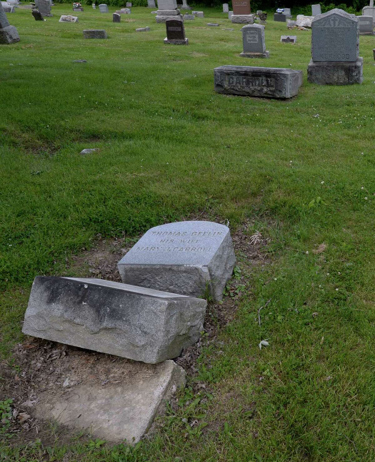 Headstones rest on the ground near their sites at the St. John's Cemetery Thursday afternoon June 19, 2014 in Troy, N.Y. (Skip Dickstein / Times Union)