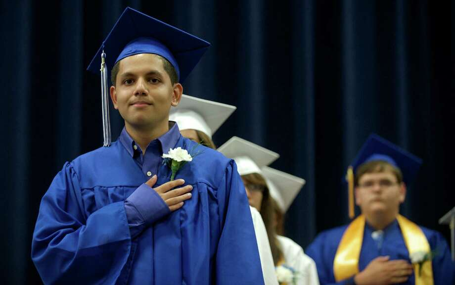 Yogesh Soni, class Valedictorian, listens to the National Anthem during the Henry Abbott Technical High School 2014 Graduation Ceremony, on Thursday, June 19, 2014, held at the Western Connecticut State University O'Neill Center. Photo: H John Voorhees III / The News-Times Freelance