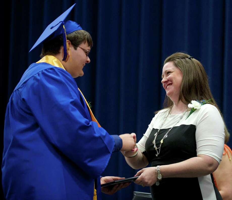 Class President Jose Alves receives his diploma and a hank shake from Principal Stacy Butkus during the Henry Abbott Technical High School 2014 Graduation Ceremony, on Thursday, June 19, 2014, held at the Western Connecticut State University O'Neill Center. Photo: H John Voorhees III / The News-Times Freelance