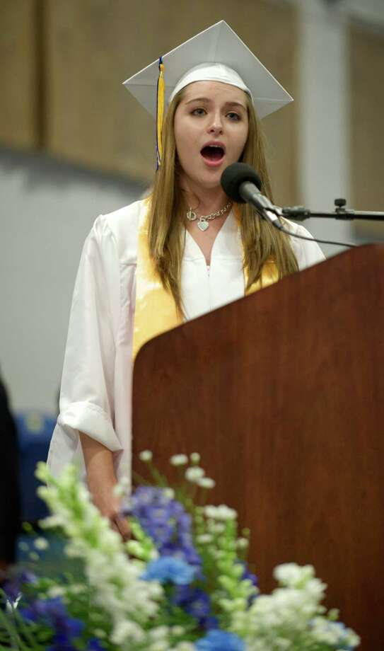 Gabriella Cecere, 17, of Danbury, sings the National Anthem during the Henry Abbott Technical High School 2014 Graduation Ceremony, on Thursday, June 19, 2014, held at the Western Connecticut State University O'Neill Center. Photo: H John Voorhees III / The News-Times Freelance
