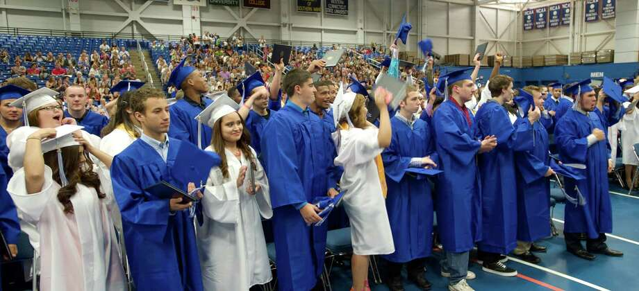 2014 graduates cheer after their last classmate had received their diploma during the Henry Abbott Technical High School 2014 Graduation Ceremony, on Thursday, June 19, 2014, held at the Western Connecticut State University O'Neill Center. Photo: H John Voorhees III / The News-Times Freelance