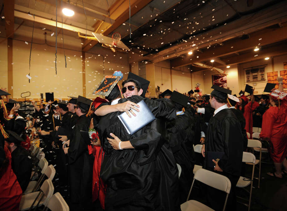 Graduates Brandon Carfora, left, and James Bird hug as confetti rains down at the conclusion of the Platt Technical High School Class of 2014 Graduation in Milford, Conn. on Thursday, June 19, 2014. Photo: Brian A. Pounds / Connecticut Post