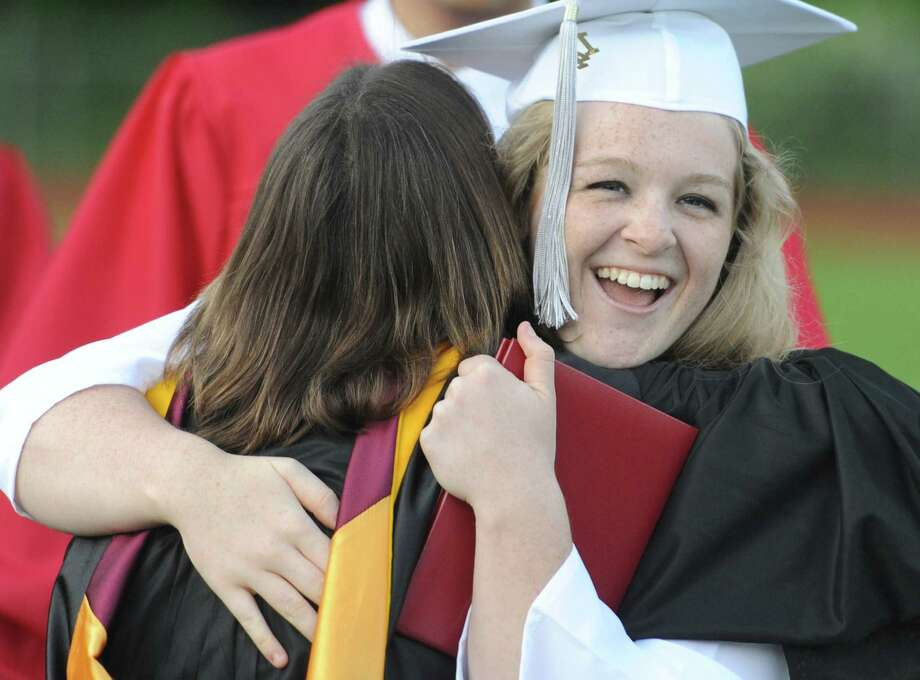 Madison Caballero gives a hug after receiving her diploma at the Masuk High School 2014 Graduation Ceremony at Masuk High School in Monroe, Conn. Thursday, June 19, 2014. Photo: Tyler Sizemore / The News-Times