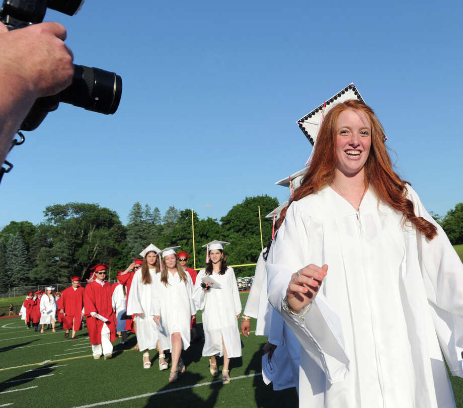 At right, Bailey Robben smiles as she marches into Cardinal Stadium with other graduating seniors during the Greenwich High School graduation ceremony at the school in Greenwich, Conn., Thursday night, June 19, 2014. Photo: Bob Luckey / Greenwich Time