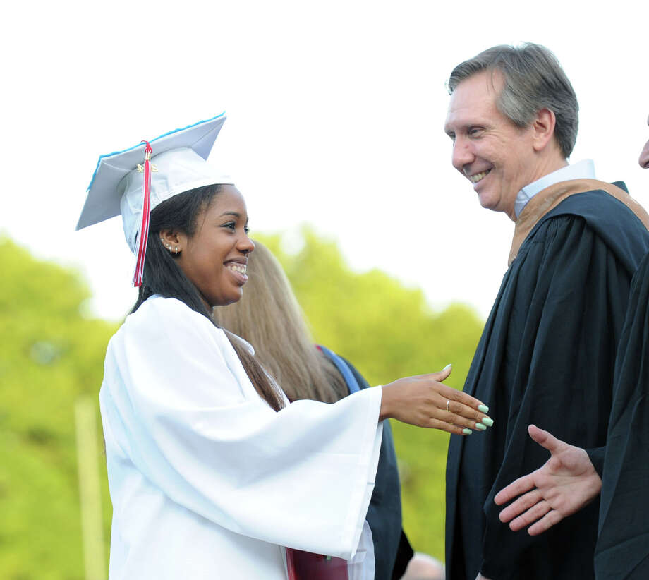 Breyana Baxter, 18, receives her diploma during the Greenwich High School graduation ceremony at the school in Greenwich, Conn., Thursday night, June 19, 2014. At right is Greenwich Board of Education member, Peter Sherr. Photo: Bob Luckey / Greenwich Time