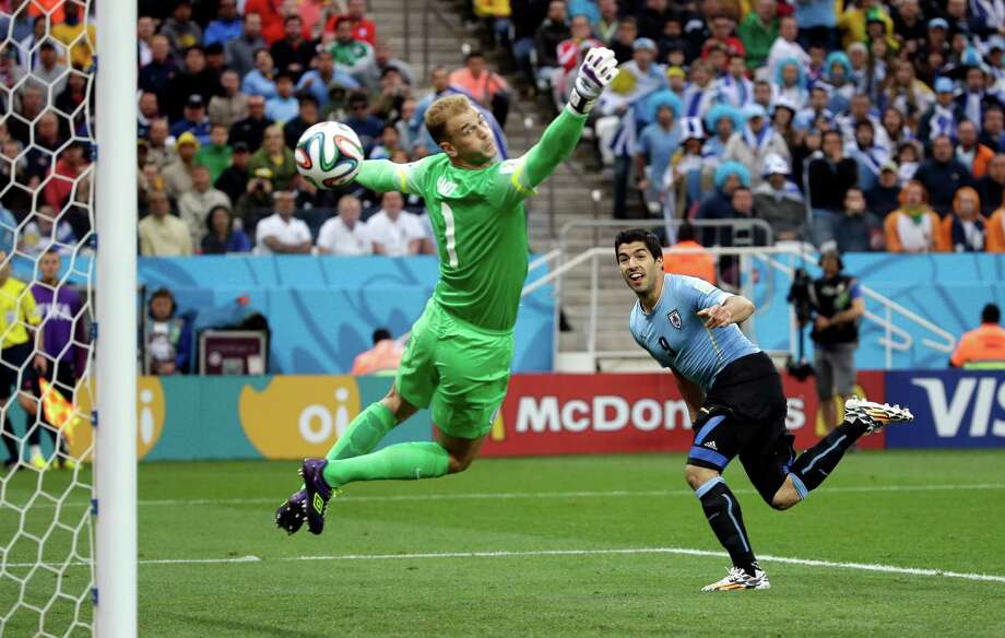 England's goalkeeper Joe Hart can't stop Uruguay's Luis Suarez's header to score his side's first goal during the group D World Cup soccer match between Uruguay and England at the Itaquerao Stadium in Sao Paulo, Brazil, Thursday, June 19, 2014.  (AP Photo/Felipe Dana) ORG XMIT: WCDP185 Photo: Felipe Dana / AP