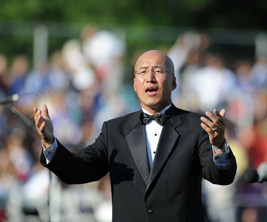 John Yoon, the Greenwich High School band director, during the graduation ceremony at the school in Greenwich, Conn., Thursday night, June 19, 2014. Photo: Bob Luckey / Greenwich Time