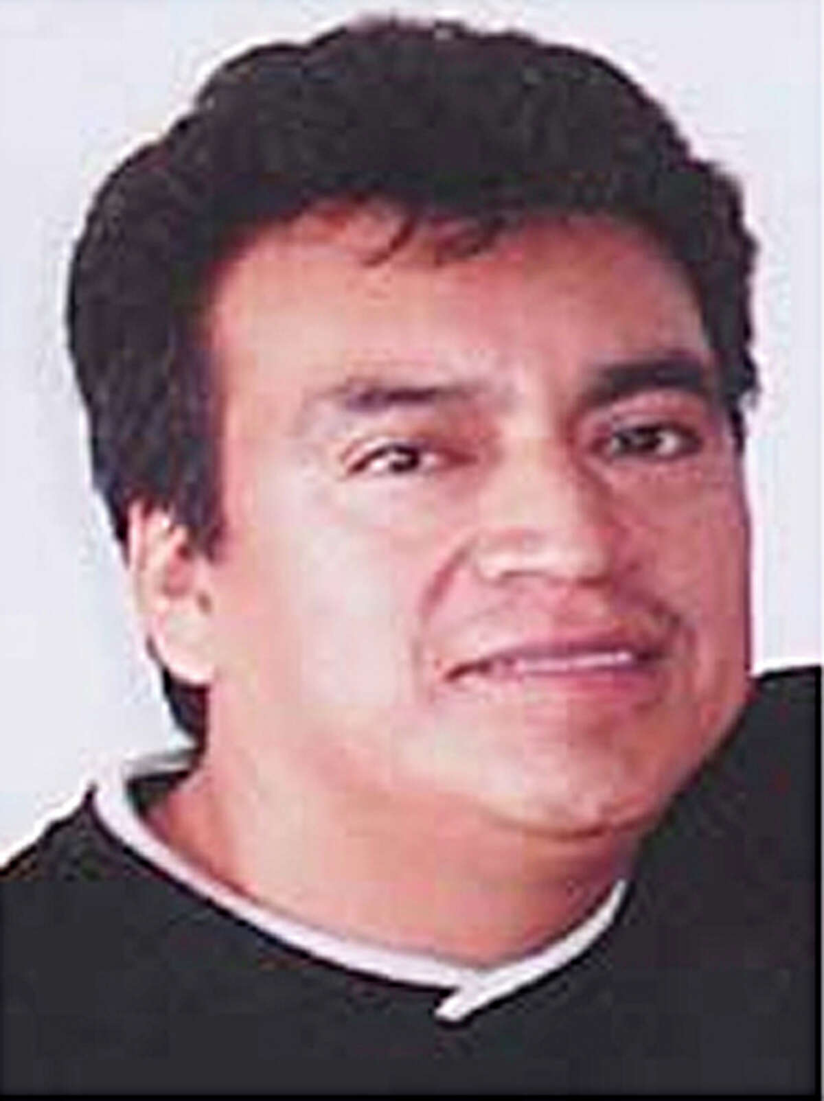 """(PROVIDED PHOTO BY THE FBI) Gerardo """"El Gallo"""" Salazar Federal police in Mexico say they arrested Gerardo Salazar who is on the FBI's most wanted list for allegedly trafficking women and minors for prostitution in Houston. Tuesday, March 2, 2010, in Houston."""