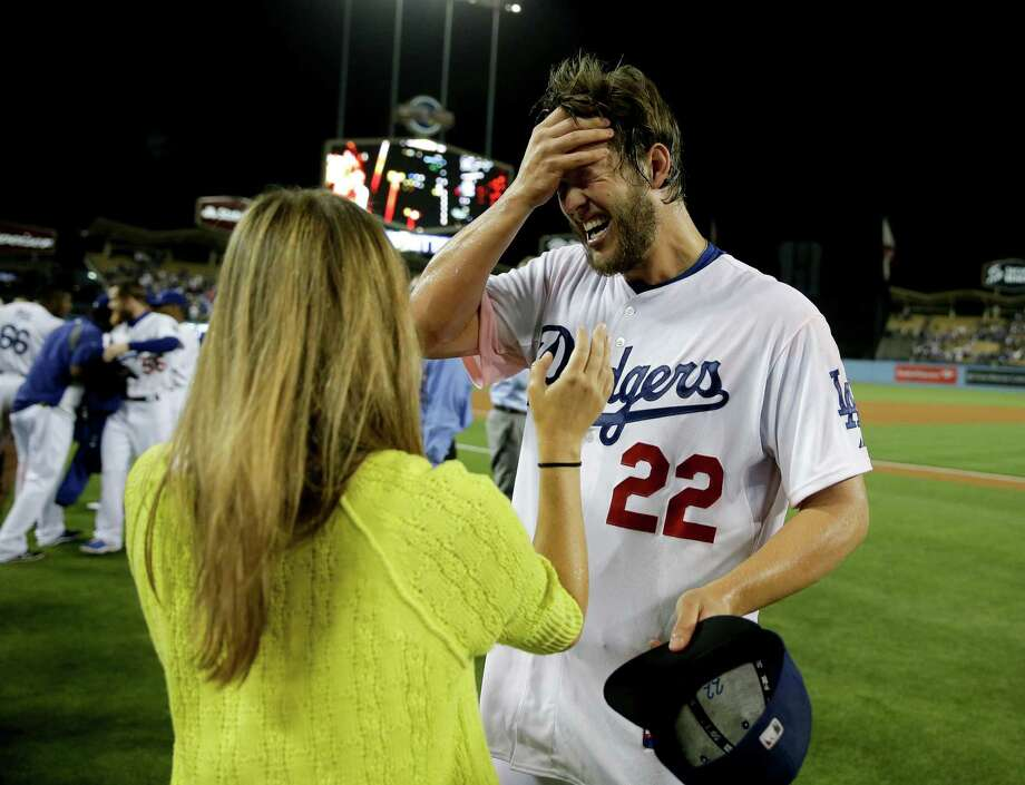 Dodgers ace Clayton Kershaw, right, celebrates on the field with his wife Ellen after no-hitting the Rockies on Wednesday. Photo: Chris Carlson, STF / AP
