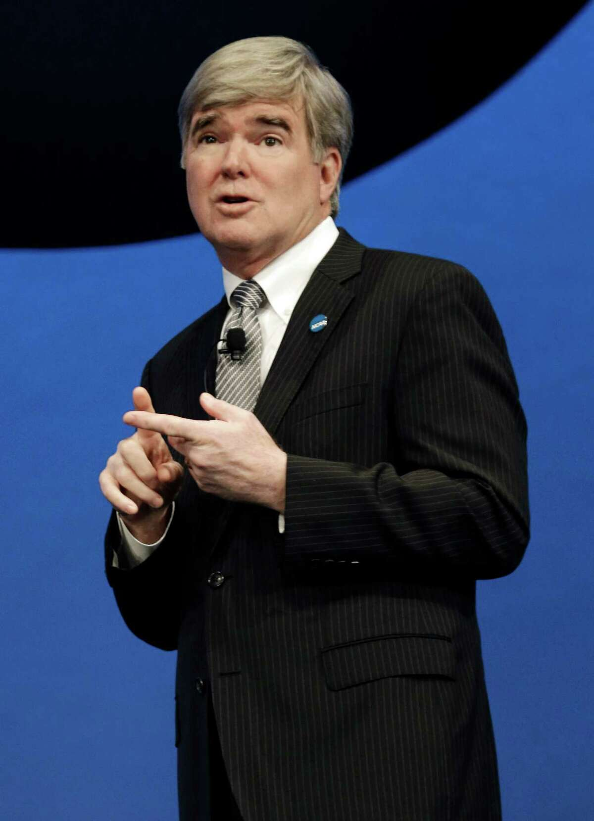 NCAA President Mark Emmert speaks at the organization's annual convention, Thursday, Jan. 17, 2013, in Grapevine, Texas. Emmert delivered his state of the association address on the second day of the group's convention, where several reform measures are on the agenda in the wake of high-profile scandals. The board could make sweeping changes this week, including rules about communicating recruits. (AP Photo/LM Otero)