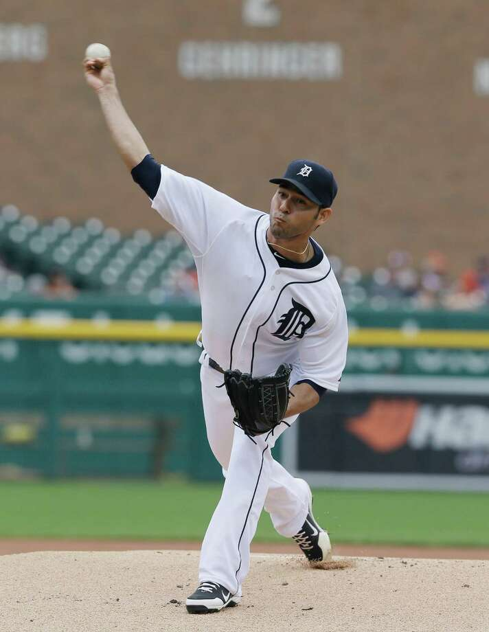 Detroit Tigers starting pitcher Anibal Sanchez throws during the first inning of a baseball game against the Kansas City Royals in Detroit, Thursday, June 19, 2014. (AP Photo/Carlos Osorio) ORG XMIT: MICO101 Photo: Carlos Osorio / AP