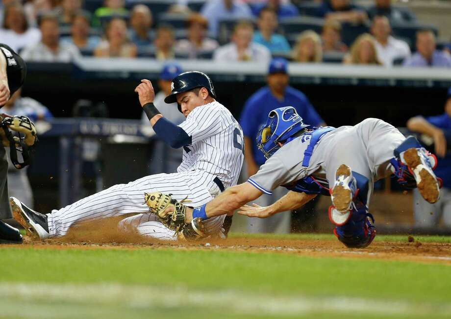 NEW YORK, NY - JUNE 19:  Jacoby Ellsbury #22 of the New York Yankees scores on a sacrifice fly by Carlos Beltran #36 (not pictured) in the third inning against the Toronto Blue Jays at Yankee Stadium on June 19, 2014 in the Bronx borough of New York City.  (Photo by Mike Stobe/Getty Images) ORG XMIT: 477585251 Photo: Mike Stobe / 2014 Getty Images