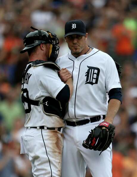 Tigers closer Joe Nathan, right, and Bryan Holaday enjoy a much-needed win over the Royals. Photo: Kirthmon F. Dozier, MBR / Detroit Free Press