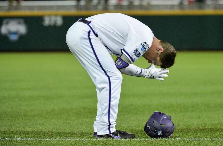 TCU third baseman Derek Odell reacts after the last out against Mississippi in an NCAA baseball College World Series elimination game in Omaha, Neb., Thursday, June 19, 2014. Mississippi won 6-4. (AP Photo/Ted Kirk) Photo: Ted Kirk, Associated Press / FR34398 AP