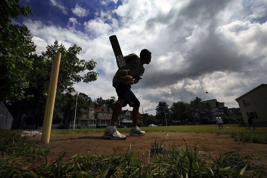 Nirav Patel, 15, of Scranton, Pa., formerly of India, plays cricket with his friends in an empty lot on Thursday, June 19, 2014, in downtown Scranton, Pa. (AP Photo/The Scranton Times-Tribune, Butch Comegys)  WILKES-BARRE TIMES-LEADER OUT; MANDATORY CREDIT Photo: Butch Comegys, Associated Press