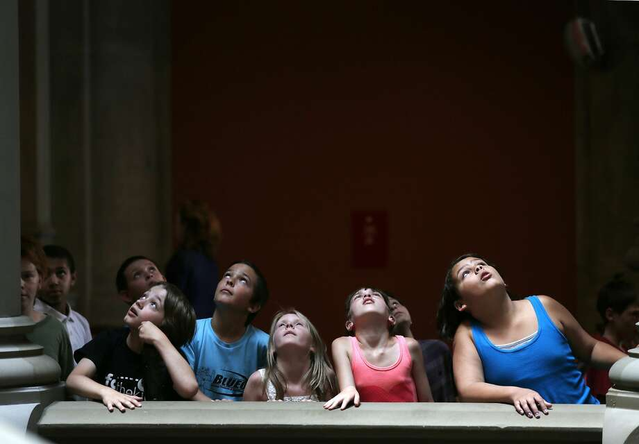 Fourth-grade students from Granville Central Schools in Granville, N.Y., look at a skylight on the Assembly Staircase during a tour of the Capitol on Thursday, June 19, 2014, in Albany, N.Y. Lawmakers plan to work through hundreds of bills before adjourning late Thursday night or perhaps Friday after the six-month session. (AP Photo/Mike Groll) Photo: Mike Groll, Associated Press