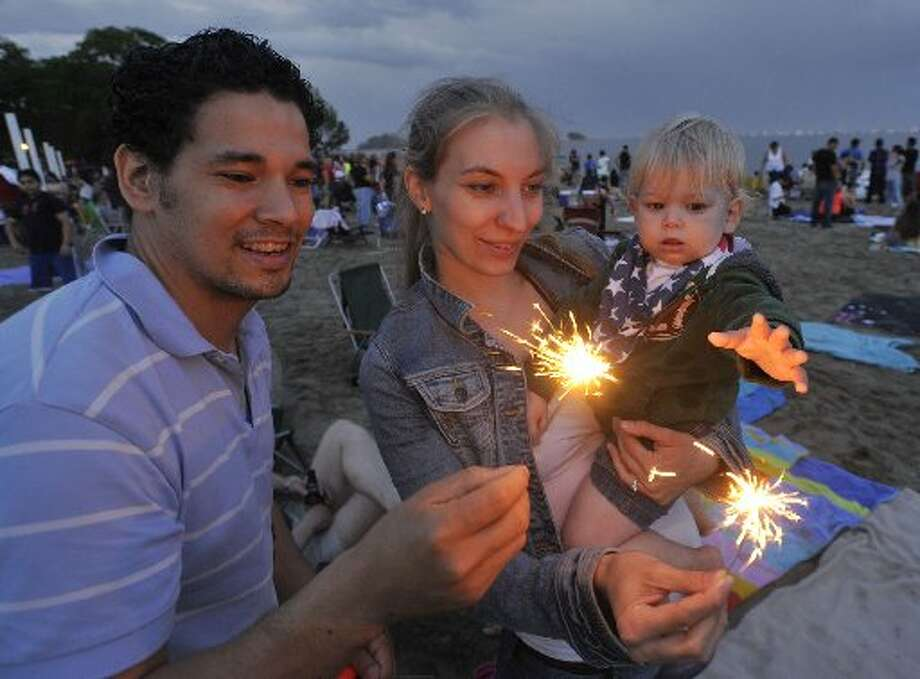 This daddy and mommy  have it right - not allowing their child to hold a sparkler.