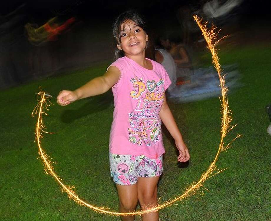 This child has it wrong - she needs to be 16 to play with sparklers.