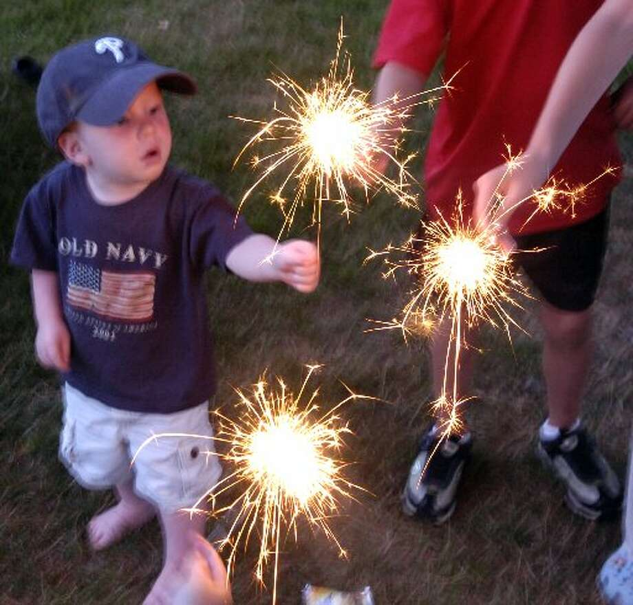 This child of two is definitely under age to play with sparklers - he needs to be 16 to be legal. Photo by Keelin Daly.