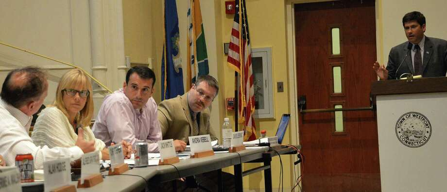 Selectman Avi Kaner, at podium, and Planning and Zoning Commissioner Jack Whittle, far left, had a disagreement over a proposal to change a text amendment that would roll back the number of affordable units at the proposed Baron's South housing complex. Photo: Jarret Liotta / Westport News