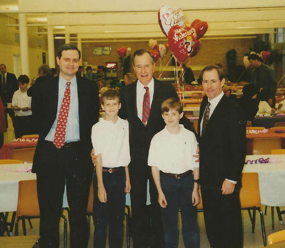 Sharon Bush, the former wife of Neil Bush, is auctioning off a handful of pieces of furniture that the Bush family used during family functions here in Houston. Included is an antique oak table that Bush says was popular with Bush 41. This photo was found in one of the cabinets, appearing to show Bush 41 at a funcrtion with grandkids.  Photo: Bold Bids / Bush Family