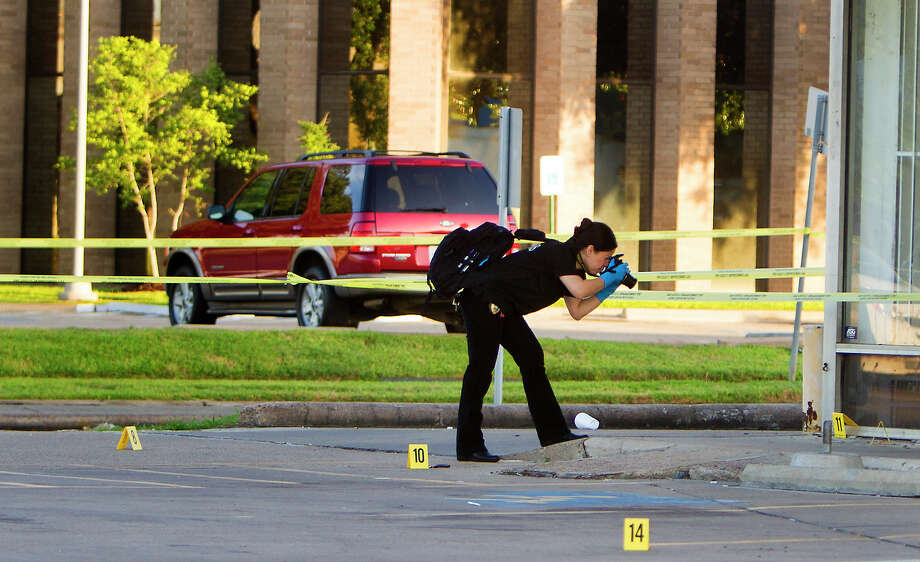 Authorities investigate the scene of a fatal shooting in the 4000 block of Tanglewilde, Friday, June 20, 2014, in Houston. Police said the victim, whose name has not been released, died at the scene. Investigators said it appeared some patrons inside the club had a altercation and were asked to leave when an argument apparently continued outside the club and shots were fired. Photo: Cody Duty, Houston Chronicle / © 2014 Houston Chronicle