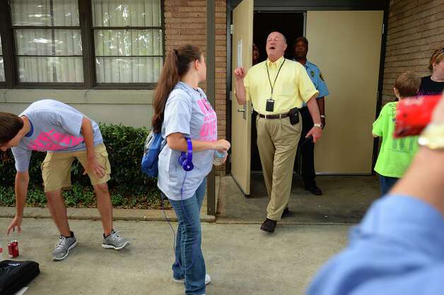 Phillip Brooks announces to a waiting crowd that the Beaumont Independent School District's Thursday night meetings had been canceled. When asked why, no answer was given. 