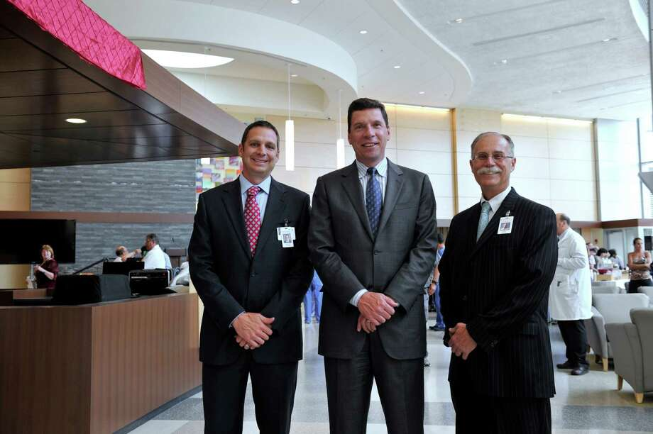 Danbury Hospital has completed its latest expansion - The Peter and Carmen Lucia Buck Pavilion. The 11-story, state-of-the art building is named for Dr. Peter Buck and his late wife. Dr. Buck donated $10 million to support the building of the Pavilion. The formal dedication is Friday, June 20, 2014. from left are, Michael Daglio, COO, Dr. John Murphy, president and Morris Gross, vice president for facilities. Photo: Carol Kaliff / The News-Times
