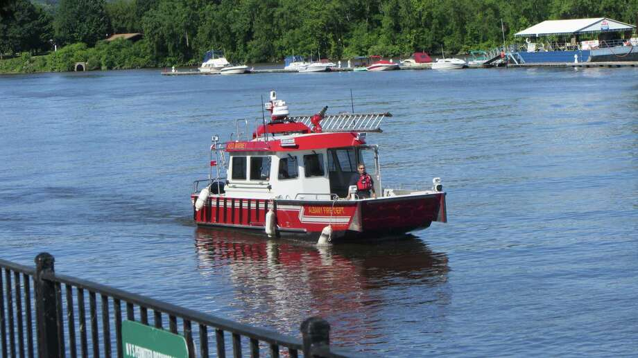 An Albany Fire Department boat arrives on the scene of a Hudson River search for a man missing since Thursday near Troy. (Bob Gardinier/Times Union)