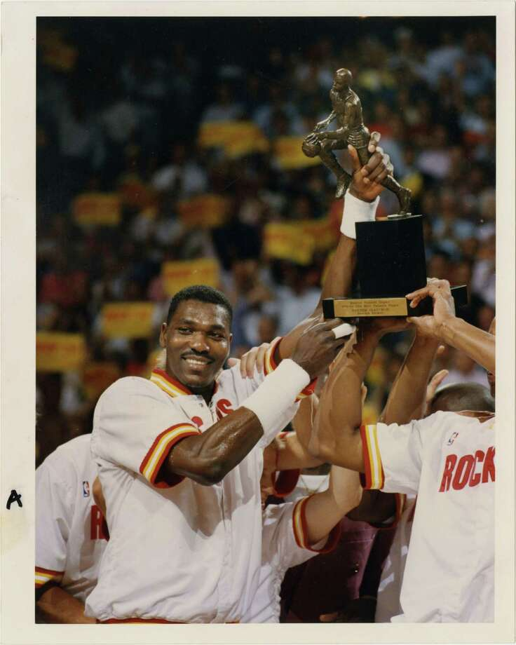We'll get you Hakeem's autograph.You can be a part of a team lineage that includes this guy. He may even autograph some stuff for you.  Photo: Robert Seale, HP Staff / Houston Post files