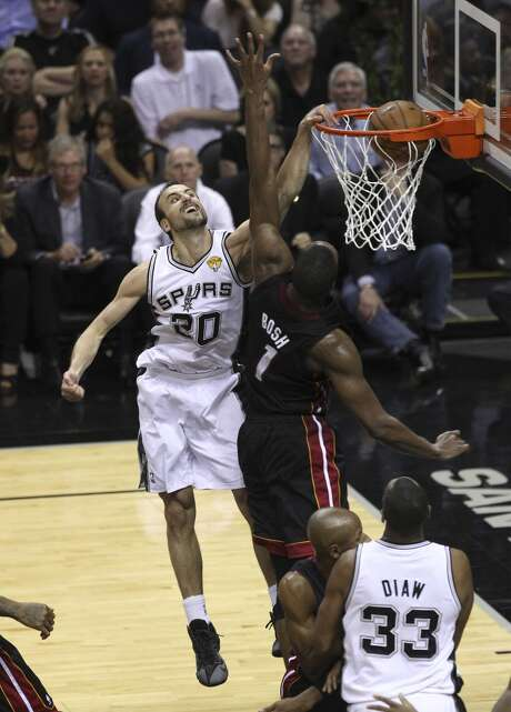 San Antonio Spurs' Manu Ginobili dunks over Miami Heat's Chris Bosh in the second quarter of Game 5 of the 2014 NBA Finals at the AT&T Center on Sunday, June 15, 2014. (Kin Man Hui/San Antonio Express-News) Photo: Kin Man Hui, San Antonio Express-News
