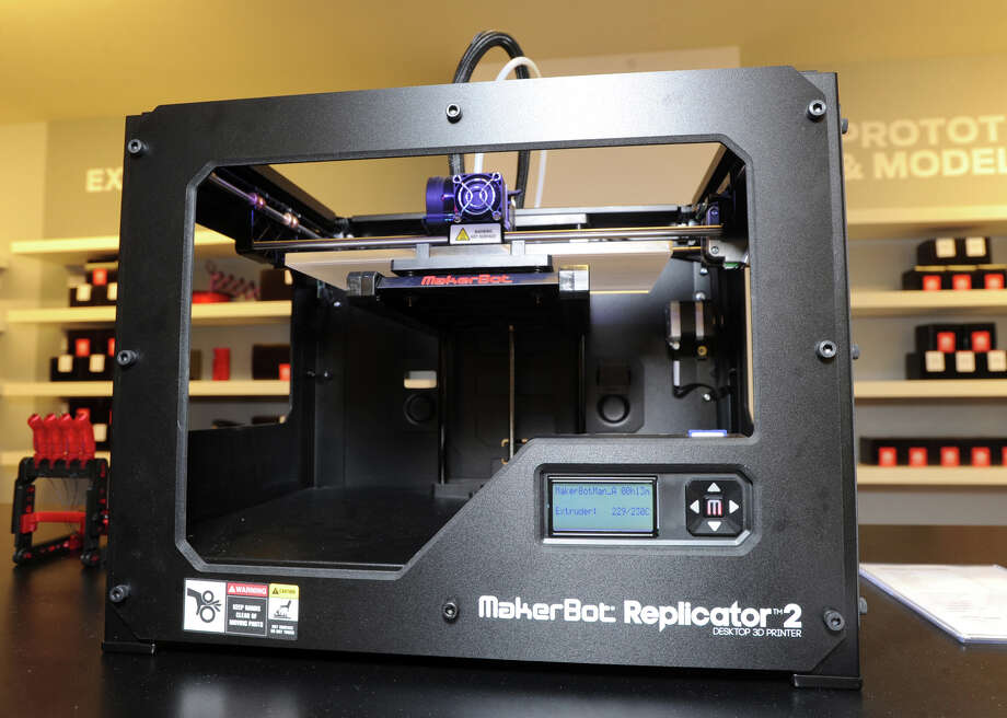 The MakerBot Replicator 2, a 3D printer, during the grand opening of the MakerBot Store-Greenwich at 72 Greenwich Ave., Friday, Nov. 22, 2013. Fans of 3D printing can get a hands-on lesson when they visit the MakerBot store in Greenwich this weekend. Photo: Bob Luckey / Greenwich Time