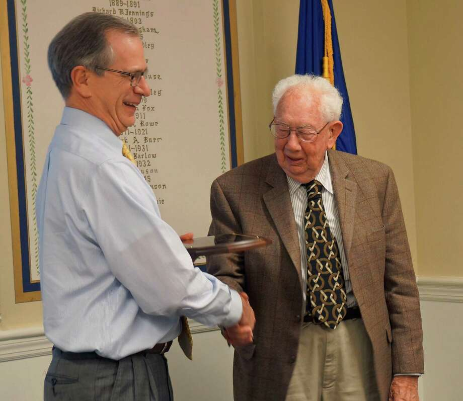Conservation Commission Chairman Kevin Gumpper presents Frank Rice with a plaque honoring his 15 years on the panel. Photo: Genevieve Reilly / Fairfield Citizen