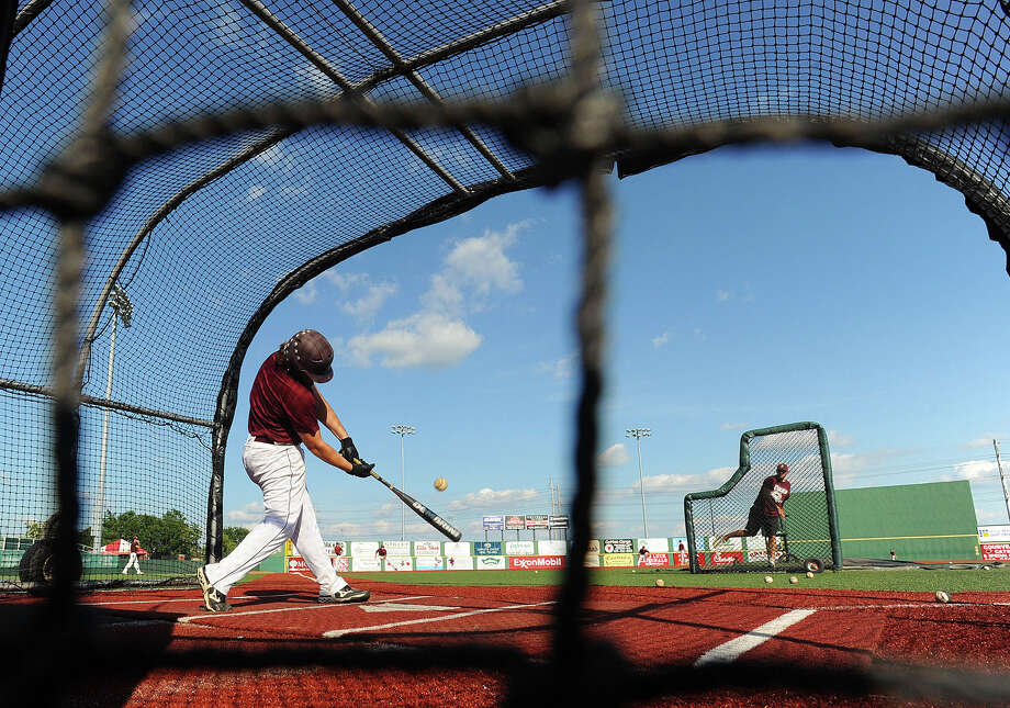 Silsbee's Brayden Griffin slams the ball during Monday's practice at Lamar's stadium. The Tigers played on Cardinal grounds to familiarize themselves with the turf they will play on during Wednesday's semifinals at the University of Texas.  Photo taken Monday, June 3, 2013 Guiseppe Barranco/The Enterprise Photo: Guiseppe Barranco, STAFF PHOTOGRAPHER / The Beaumont Enterprise