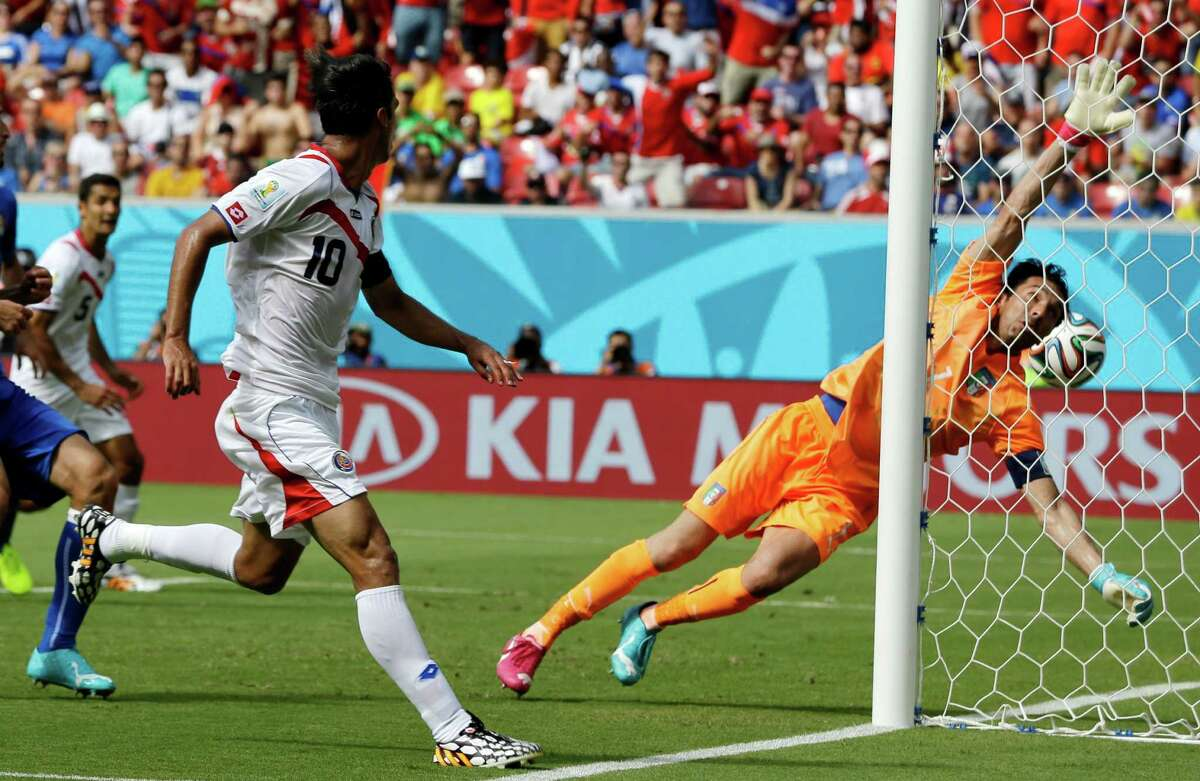 Costa Rica's Bryan Ruiz (10) watches as the ball goes past Italy's goalkeeper Gianluigi Buffon to score his side's first goal during the group D World Cup soccer match between Italy and Costa Rica at the Arena Pernambuco in Recife, Brazil, Friday, June 20, 2014. (AP Photo/Ricardo Mazalan)