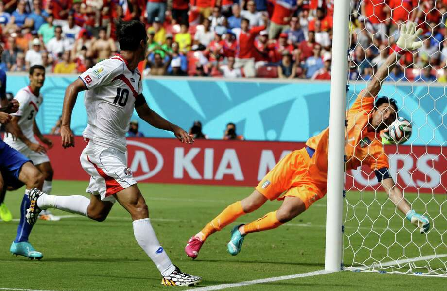 Costa Rica's Bryan Ruiz (10) watches as the ball goes past Italy's goalkeeper Gianluigi Buffon to score his side's first goal during the group D World Cup soccer match between Italy and Costa Rica at the Arena Pernambuco in Recife, Brazil, Friday, June 20, 2014.  (AP Photo/Ricardo Mazalan) Photo: Ricardo Mazalan, Associated Press / AP