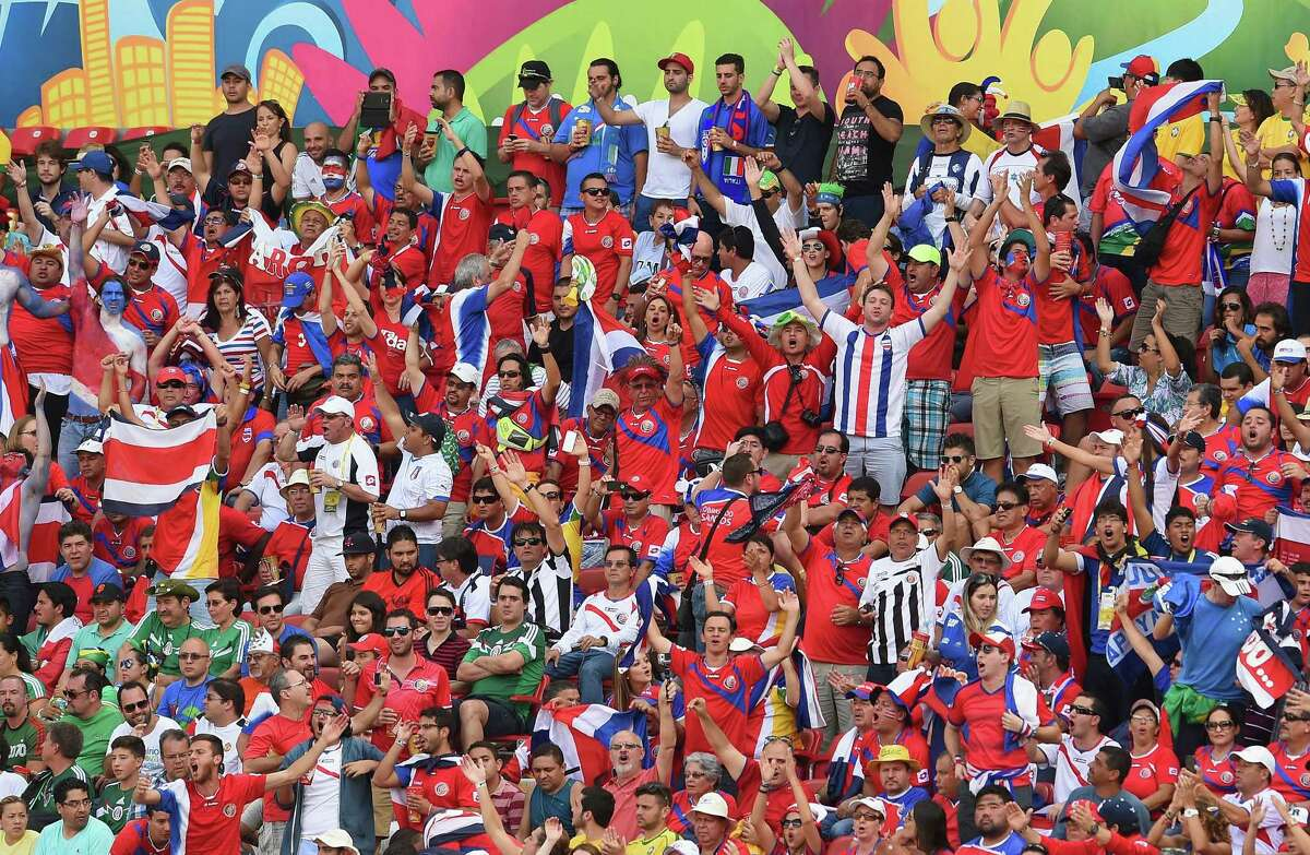 RECIFE, BRAZIL - JUNE 20: Fans cheer during the 2014 FIFA World Cup Brazil Group D match between Italy and Costa Rica at Arena Pernambuco on June 20, 2014 in Recife, Brazil.