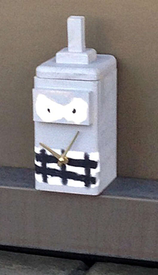 This suspicious box with a smiling face and clock hands discovered on the Unquowa Road overpass near the railroad tracks in Fairfield Conn. caused Metro-North to shut down service in the area, resulting in hours of delays on the New Haven Line on Friday, June 20, 2014. The box was determined to not be a bomb, but a student project. Photo: Contributed Photo / Connecticut Post Contributed