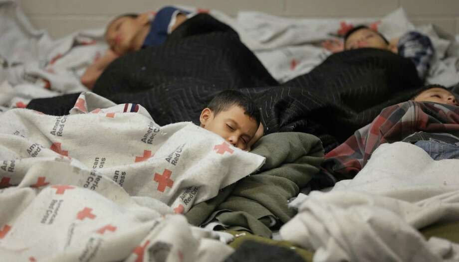 Detainees sleep in a holding cell Wednesday at a Customs and Border Protection facility in Brownsville. Photo: Eric Gay, POOL / Pool AP