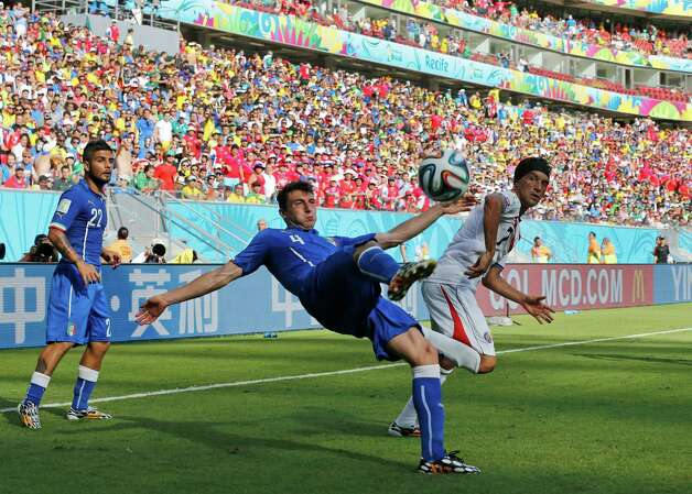 Italy's Matteo Darmian clear the ball during the group D World Cup soccer match between Italy and Costa Rica at the Arena Pernambuco in Recife, Brazil, Frid