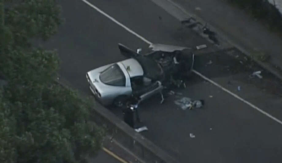 Berkeley police inspect a solo-vehicle collision blocking Eastbound Tunnel Road Friday morning. Photo: CBS San Francisco