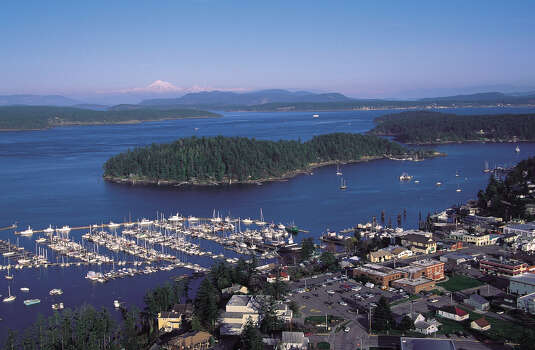 The picturesque harbor at San Juan Island's Friday Harbor offers views of Washington's Mt. Baker in the distance Photo: Mark Gardener