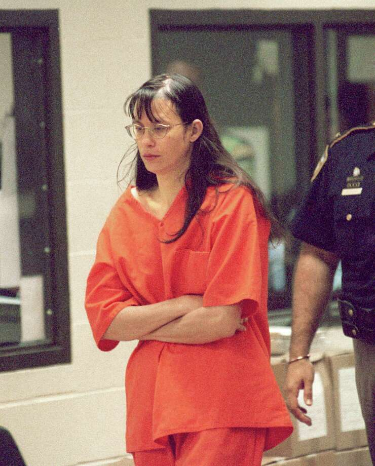 Andrea P. Yates, charged with capital murder in the confessed drownings of her five children last Wednesday, departs following her arraignment Friday morning in the state district court of Judge Belinda Hill in an auxiliary Harris County court room.  POOL AVAILABLE.  Photo by Steve Ueckert / Chronicle.  Photo: Steve Ueckert, Houston Chronicle / Houston Chronicle