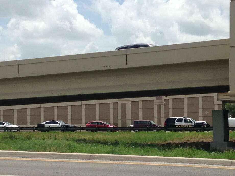 Officials investigate a dead body found on Loop 410 at Vance Jackson Friday, June 20, 2014. Photo: Alia Malik/San Antonio Express-News